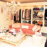 The Coveteur - closets - dressing rooms, french dressing room, chic dressing room, walk in closet, cream cabinets, closet built ins, closet built in cabinets, cream built in cabinets, cream closet cabinets, louis vuitton trunks, dressing room sofa, dressing room settee, french settee, closet sofa, closet settee, salmon pink sofa, salmon pink settee, pink sofa, pink settee, pink french sofa, pink french settee, french velvet sofa, french velvet settee, mirrored coffee table, dressing room table, sheepskin rug, closet chandeliers, dressing room chandeliers,