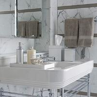 Laura Bohn Design Associates - bathrooms - bathroom chandelier, bathroom accent tiles, accent tiles, white marble tiles, bathroom marble, taupe accent tiles, taupe tiles, 2 leg washstand, frameless medicine cabinet,