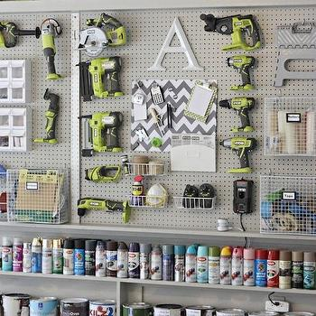The Creativity Exchange - garages - peg board storage, peg board garage wall, painted peg board, peg board wall, peg board storage wall, peg board tool storage, peg board organization, garage storage, garage organization, garage shelving, tool storage, spray paint storage, spray can storage, wall hung tool storage, garage peg boards, adjustable tool storage, wire storage baskets, peg board baskets, chevron pinboard, gray and white chevron message board, garage peg boards, peg board garage,