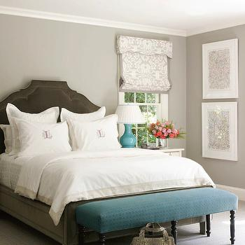 Lindsey Coral Harper - bedrooms: gray walls, gray wall color, gray bedroom walls, beige wall to wall carpet, wall to wall carpeting, teal bench, upholstered teal bench, teal bench with black legs, teal bench with turned black legs, bench at foot of bed, bench at end of bench, dark taupe velvet bed, taupe velvet bed, monogrammed pillow cases, ivory bedding, ivory bed linens, extra wide nightstand, vertically hung, stacked art, art hung vertically, gray abstract, framed abstract art, turquoise table lamp, ceramic turquoise lamp, turquoise lamp with pleated shade, nightstand in front of window, bedside table in front of window, gray and ivory damask roman shade, gray damask window shade, snakeskin purse, taupe velvet arched headboard, dark taupe velvet headboard, gray and blue bedrooms, dark gray velvet headboard, taupe velvet headboards, turquoise lamps, gray damask roman shade,