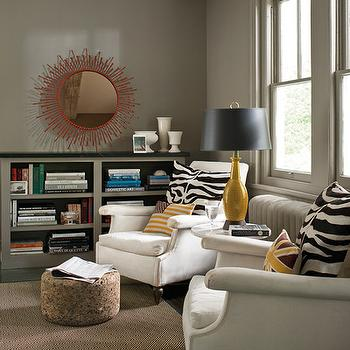 Benjamin Moore - dens/libraries/offices - taupe paint, taupe paint colors, taupe wall colors, benjamin moore taupe, wood beams, den, red mirror, built ins, den built ins, taupe built ins, taupe built in cabinets, taupe bookcase, taupe bookshelf, mustard yellow lamp, roll arm sofa, rolled arm sofa, zebra pillows, cork ottoman, round cork ottoman,