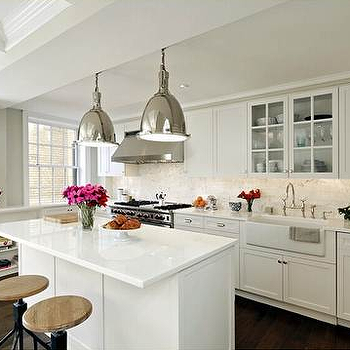 kitchens - countertop overhang, overhang countertop, white shaker cabinets, shaker cabinets, white countertops, marble slab backsplash, glass front cabinets over sink, cabinets over sink, cabinets above sink, farmhouse sink, industrial counter stools, industrial pendants, Benson Pendant,