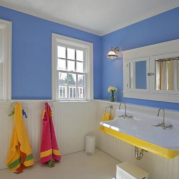 Block Builders Group - bathrooms - yellow and blue bathroom, yellow and blue kids bathroom, bright blue walls, bright blue bathroom walls, beadboard paneling, beadboard half wall, beadboard in bathroom, beadboard wainscoting, beadboard half bath, yellow wall sink, vintage style wall mount sink, wall mounted sink, wall mount sink with double faucet, wall mounted sink with double faucet, vintage style sink with dual faucet, wall mount yellow sink, yellow towel, towel ring, towel loop, towel hooks, sash window, white double door medicine cabinet, mirrored medicine cabinet, white mirrored double door medicine cabinet, prismatic glass wall sconce, prismatic glass and nickel wall sconce, white penny tile, kids bathroom, kids bath, kids bathroom, yellow sink, yellow bathroom sink, kids sinks, kids bath sinks, kids bathroom sinks, shared kids sink, double medicine cabinet, inset double medicine cabinet, framed double medicine cabinet,