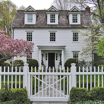 home exteriors - cape cod, cape cod home, white picket fence, cottage home,  Cape cod home features with white siding, gray shingles and portico