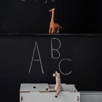 Sissy and Marley - nurseries - black chalkboard wall, chalkboard wall, chalkboard nursery, chalkboard nursery wall, chalkboard accent wall, chalkboard focal wall, white toy trunk, modern white toy trunk, white toy box, faux giraffe taxidermy, nursery chalkboard, nursery chalkboard wall,