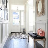 Tracey Ayton Photography - entrances/foyers - photo wall, black and white photo wall, long foyer, foyer photo wall, wainscoting, white wainscoting, foyer wainscoting, entry wainscoting, wainscoting foyer, oak wood floor, long entry, french bench, black tufted bench, black french bench,