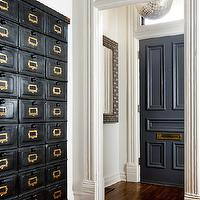 Toronto Interior Design Group - entrances/foyers - disco ball pendant, dark gray door, transom window, vintage card catalog, vintage cabinet, black vintage cabinet, black vintage card catalog cabinet,