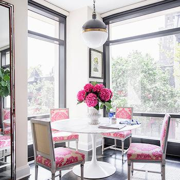 Domino Magazine - dining rooms - pink chairs, pink damask chairs, damask dining chairs, pink damask dining chairs, square back chairs, square back dining chairs, marble top dining table, floor to ceiling windows, beveled floor mirror, pink square back dining chairs, Hicks Pendant,