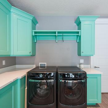 Mountain Cabinetry - laundry/mud rooms - teal cabinets, teal laundry room cabinets, laundry room cabinets, white countertops, black washer dryer, black washer and dryer,