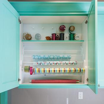 Mountain Cabinetry - laundry/mud rooms - teal cabinets, white countertops, black washer dryer, wrapping paper station, craft room, craft room ideas,