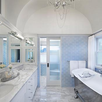 Tom Stringer - bathrooms - Benjamin Moore - White Dove - blue subway tiles, blue subway tiled wall, blue subway tile backsplash, cast iron bathtub, cast iron tub, vintage tub filler, vintage style tub filler, white and gray marble, white and gray marble floor, frosted glass windows, waterworks subway tiles, waterworks tiles, barrel ceiling, bathroom barrel ceiling, barrel ceiling bathroom, pocket door, glass pocket door, frosted glass pocket door, pocket door bathroom, white framed mirror, white double vanity, water closet,
