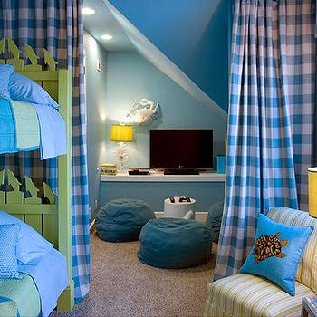 HGTV - boy's rooms - bright aqua blue walls, bright blue walls, green and blue bedroom, green and blue kids room, shared kids room, gingham drapes, gingham curtains, blue and white gingham drapes, room dividing drapes, room dividing curtain, kids tv nook, kids tv niche, kids tv cubby, carpet, beige carpet, teal blue beanbag, white stool, tv ledge, flat screen tv, sloped ceiling, blue painted ceilings, white bird and branch table lamp, white crab wall decor, papier mache crab wall decor, green and white striped chair, armless chair, green and white slipper chair, turquoise turtle pillow, sea turtle pillow, blue bedding, aqua blue and green bed linens, lime green bunk bed, bright green bunk bed, green beach bunk bed, bunk bed with dolphin cut outs, bunk bed with dolphin trim, bright green beachy bunk bed, lime green beachy bunk bed, beach bunk room, beachy bunk room, green and blue striped throw, plaid curtains, plaid drapes, blue plaid curtains, blue and green kids room,