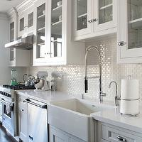 kitchens - glass front cabinets, glass front kitchen cabinets, glass upper cabinets, glass front upper cabinets, inset cabinets, lower cabinets, white quartz countertops, mini subway tiles, mini subway tile backsplash, farmhouse sink, cabinets over sink, cabinets over kitchen sink,
