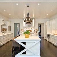 Beautiful kitchen with paneled ceiling dotted with pot lights and industrial light ...