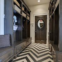laundry/mud rooms - long mudroom, chevron floor, chevron tiles, chevron tile floor, gray chevron tiles, gray chevron floor, dark brown lockers, dark brown cabinets, dark brown mudroom cabinets, mudroom bench,