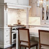 Elegant kitchen features Visual Comfort Lighting Medium Arch Top Lanterns over ...