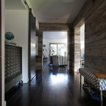 Eric Olsen Design - entrances/foyers - long foyer, long foyer ideas, chevron bench, white and gray chevron bench, rustic plank walls, plank walls, sliding doors, gray sliding doors, industrial cabinet,