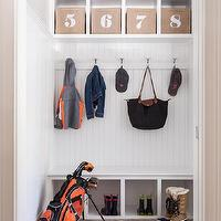 Threshold Goods and Design - laundry/mud rooms - mudroom, mudroom ideas, mud room ideas, mudroom cubbies, built in cubbies, jute bins, built in bench, mudroom bench, bench with shoe storage, beadboard backsplash, herringbone floor, mudroom shoe storage, mudroom bins, jute bins,
