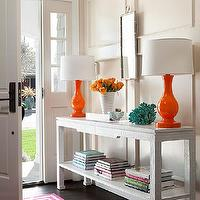 BHG - entrances/foyers - cream walls, wall trim, wall moldings, decorative wall trim, full wall wainscoting, silver bamboo mirror, faux bamboo mirror, orange lamp, orange table lamp, white console table, aqua coral, hot pink rug, hot pink greek key rug, pink greek key rug,