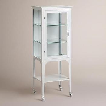 Storage Furniture - Large White Giselle Cabinet | World Market - vintage style glass cabinet, white glass front rolling cabinet, white metal glass front cabinet, white metal rolling bathroom cabinet, vintage style white metal cabinet,