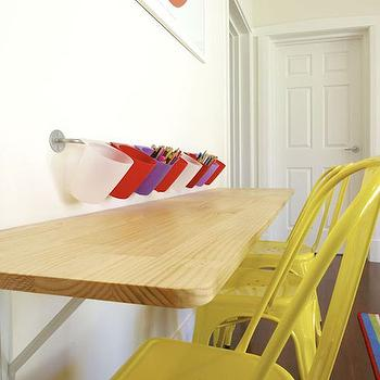 Collected Int - boy's rooms - kids desk, built in kids desk, built in homework desk, built in kids workstation, wall mount kids desk, wall length built in kids desk, yellow metal kids desk, yellow tabouret kids chair, child sized yellow metal chair, kids playroom, kids playroom desk, kids art desk, built in kids art table, wall mount kids art table, wall mount pencil holder, wall mount pencil organizer, built in desk, homework desk, yellow desk chairs,
