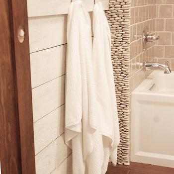 DIY Diva - bathrooms - Benjamin Moore - Maritime White - hickory floors, hickory hardwood floors, bath shower combo, tub shower combo, white tub, pebble tile, pebble tile shower, shiplap clad half walls, shiplap half wall, shiplap wainscoting, paneled half wall, horizontal paneled half wall, towel hooks, creamy white walls, creamy white wall color, glazed shower tile, glazed shower tile, kohler arch tub, river rocks, river rock backsplash, river rock walls,