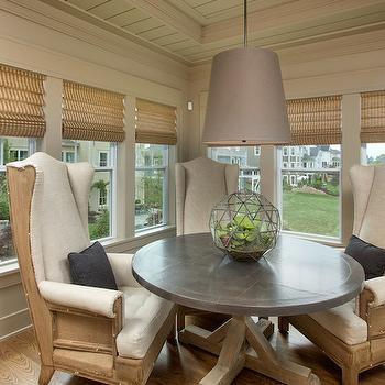 RH Homes - dining rooms - Benjamin Moore - Rocky Beach - breakfast nook, breakfast nook ideas, round dining table, round salvaged wood dining table, concrete top dining table, round concrete dining table, wing dining chairs, wingback dining chairs, gray light pendant, x base dining table,