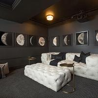 RH Homes - media rooms - Restoration Hardware - Obsidian - media room, chic media rooms, black and white media room, black and white movie room, movie room, home movie rooms, movie room ideas, black walls, white tufted sofa, white tufted ottoman, brass accent tables,