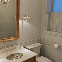 Leo Designs Chicago - bathrooms: shutters, gray shutters, bathroom shutters, gray walls, gray wainscoting, bathroom wainscoting, beveled vanity mirror, wood beveled mirror, stained bath vanity, stained washstand, white marble countertop, hammered sink, hammered oval sink, bathroom sconces,