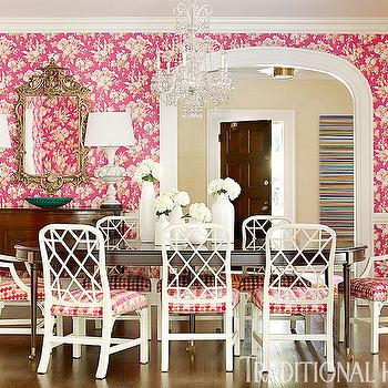 Traditional Home - dining rooms - pink dining room, white and pink dining room, dining room wallpaper, pink wallpaper, white and pink wallpaper, pink floral wallpaper, dining room chair rail, chair rail dining room, bar cart, brass bar cart, antique sideboard, antique mirror, arched doorway, oval dining table, espresso dining table, oval espresso dining table, espresso oval dining table, white dining chairs, lattice dining chairs, white lattice dining chairs, lattice back dining chairs, pink seat cushions,
