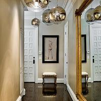 entrances/foyers - foyer hall, foyer hallway, long hall, long hallway, foyer lighting, foyer pendants, gold mirror, baroque mirror, gold baroque mirror, cluster of lights, mirror ball pendants, mirror ball light pendants, tom dixon pendants, tom dixon lights,