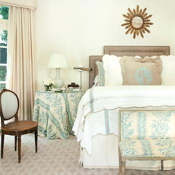 Atlanta Homes & Lifestyles - bedrooms - scalloped bedding, scalloped bed sheets, bench at foot of bed, bench at end of bed, turquoise and ivory floral bench, skirted table, skirted round table, skirted nightstand, turquoise and ivory skirted table, floral skirted table, pale gray table lamp, pale gray ceramic table lamp, french oval back chair, oval back chair with cane seat, ivory floor length drapes, ivory floor length curtains, pleated valance, box pleated valance, burlap pillow, ruffled burlap pillow, monogrammed burlap pillow, turquoise and taupe trimmed bedding, turquoise and taupe trimmed duvet, pleated bed skirt, box pleated bed skirt, sunburst mirror, gilt sunburst mirror, sunburst mirror over headboard, taupe headboard, upholstered taupe headboard, gray laurel leaf rug, gray and ivory patterned rug, round nightstand, round bedside table, skirted bedside table, valance and curtains,