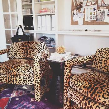 Comfy Cozy Couture - dens/libraries/offices - purple rug, kilim rug, purple kilim rug, cheetah chairs, cheetah print chairs, black accent table, office, bulletin board, built in bookcases,