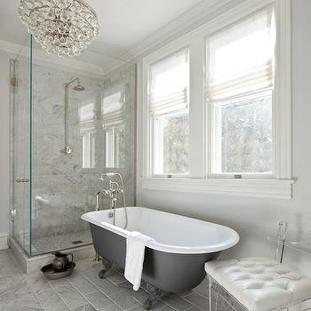 Anne Decker Architects - bathrooms - corner shower, corner shower ideas, rain shower head, marble shower surround, charcoal gray bathtub, clawfoot tub, clawfoot bathtub, charcoal gray clawfoot tub, charcoal gray clawfoot bathtub, floor mount tub filler, floor mounted tub filler, tumbled mirror, tumbled marble floor, tumbled marble tiles, lucite chair, acrylic chair, bathtub below window, bathtub under window, robert abbey chandelier, bathroom chandeliers, light grey walls, light grey bathroom walls, seamless glass shower,