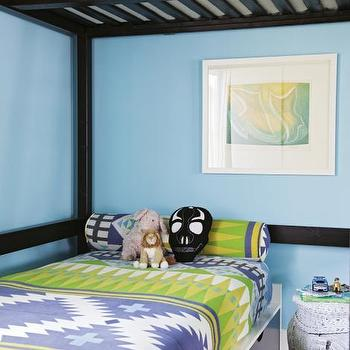 Charleston Magazine - boy's rooms - turquoise walls, turquoise wall color, green and turquoise bedroom, abstract art, framed abstract art, white rattan elephant stool, white rattan elephant side table, storage bed, kids bed with storage drawers, green and blue tribal bedding, green and blue tribal style bed linens, bedding with matching bolster pillow, loft bunk bed, loft style bunk bed, kids loft bunk bed, under the bed storage, under bed storage, under bed drawers, elephant table, white elephant table,