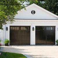 Anne Decker Architects - garages: his and her garages, black garage doors,  His and her garages with glossy black doors.