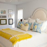 Comfy Cozy Couture - bedrooms - cream bed, cream headboard, white and blue bedding, stitched bedding, ikat pillows, yellow and blue pillows, yellow throw, yellow throw blanket, mustard yellow throw, mustard yellow throw blanket, bedroom photo wall,