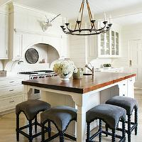 Stunning kitchen with white inset cabinets accented with nickel hardware and white ...