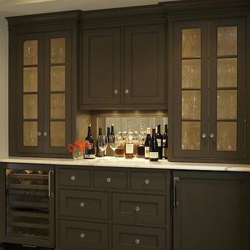 Christine Donner Kitchens - kitchens - bar ideas, home bar ideas, taupe cabinets, glass front cabinets, bar cabinets, glass door wine cooler, paneled mini fridge, concealed mini fridge, hidden mini fridge, mirror backsplash, mirrored backsplash, bar cabinet ideas,