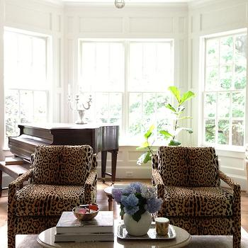 From the Right Bank - living rooms - leopard chairs, leopard print chairs, leopard armchairs, leopard print armchairs, round coffee table, hex rug, tan hex rug, david hicks rug,