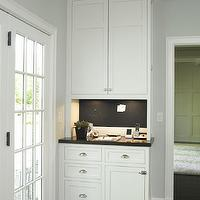 Christine Donner Kitchens - kitchens - message center, kitchen message center,  Kitchen message center features white cabinets paired with black