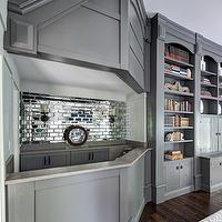 Buckingham Interiors - dens/libraries/offices - bar, home bar, home bar ideas, gray cabinets, gray bar cabinets, mirrored backsplash, mirror backsplash, mirrored subway tiles, mirror subway tiles, gray built ins, gray bookcase, gray bookshelf, home office, den,