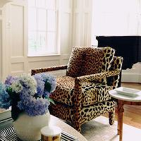 From the Right Bank - living rooms: leopard chairs, leopard print chairs, leopard armchairs, leopard print armchairs, round coffee table, hex rug, tan hex rug, david hicks rug, paneled living room,