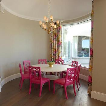 Annie Vincent Interiors - dining rooms - round dining room, circular dining room, domed ceiling, domed dining room ceiling, hardwood floors, wide planked hardwood floors, hot pink dining chair, hot pink side chair, bright pink dining chair, round white dining table, contemporary round dining table, floral curtains, beige yellow and pink floral drapes, pink and yellow floral drapes, floral drapes, floral curtains, floor length drapes, floor length curtains, brass chandelier, transitional brass chandelier, brass chandelier with white shades, burnished brass chandelier, picture window, dining room picture window, pink dining chairs, round ceilings, pink and gray curtains, pink and gray curtains,
