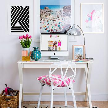 Hannah Blackmore Photography - dens/libraries/offices - gallery wall, gallery wall over desk, beach photography, aerial beach photography, beach photography art, polished nickel desk lamp, modern silver desk lamp, teal vase, pink tulips, white x sided desk, contemporary white desk, apple computer, modern white chair, white geometric back chair, pink ikat dot pillow, faux zebra hide, black and white abstract, pink and blue map of europe, framed map of europe, seagrass basket, zebra cowhide, light hardwood floors, x desk, white x desk, white x base desk,