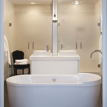 Leo Designs Chicago - bathrooms - his and hers sinks, his and hers vanity, dual vanity, dual sink vanity, shared vanity mirror, two sided sink vanity, two sided vanity mirror, two sided vanity, frosted glass shower doors, his and hers showers, master bath, master bathroom, black french chair, black french velvet chair, freestanding tub, freestanding bath, freestanding bathtub, contemporary freestanding tub, contemporary freestanding bath, floor mount faucet, floor mount tub filler, tub filler, hardwood floors, exposed silver bulb, silver bulb, silver bulb pendant, back to back vanities, back to back washstands, his and her vanities, his and her washstands, his and her showers, double shower doors, frosted glass shower doors, oval bathtub, oval freestanding bathtub, floor mounted tub filler, master bath ideas,