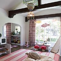 Kristen Panitch Interiors - girl's rooms: pink playroom, sophisticated playroom, girls playroom, vaulted ceiling playroom, playroom vaulted ceiling, dark wood beams, white and pink curtains, white and pink drapes, patterned curtains, patterned drapes, pink patterned curtains, playroom table, kids craft table, white teepee, playroom teepee, pink striped rug, vintage play kitchen, playroom kitchen, mushroom stools,