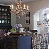 Kristen Panitch Interiors - dining rooms - arched doorway, round dining table, dining bench, curved bench, curved dining bench, gray dining bench, gray curved bench, black hutch, glass front hutch, black sideboard,