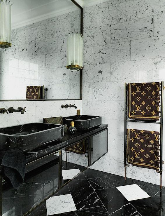 Colin Radcliffe - bathrooms - louis vuitton, louis vuitton towels, chic baths, chic bathrooms, marble clad bathroom, black lacquer mirror, art deco sconces, sconces on mirror, black sinks, vessel sinks, black vanity sinks, black vessel sinks, black marble sinks, marble vessel sinks, black marble vessel sinks, wall mounted faucets, orb faucets, black and white marble floor, black and white floor, black and white marble tiles, floating vanity, floating washstand, black marble counters, black marble countertops, black floating vanity, black floating washstand, towel warmer,