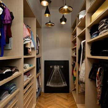 closets - closet, walk in closet, long closets, long walk in closets, beat light, tan closet cabinets, wood herringbone floor, herringbone wood floor,